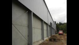 Kompletní dodávka a montáž opláštění budov, hal, jízdáren a ocelových konstrukcí