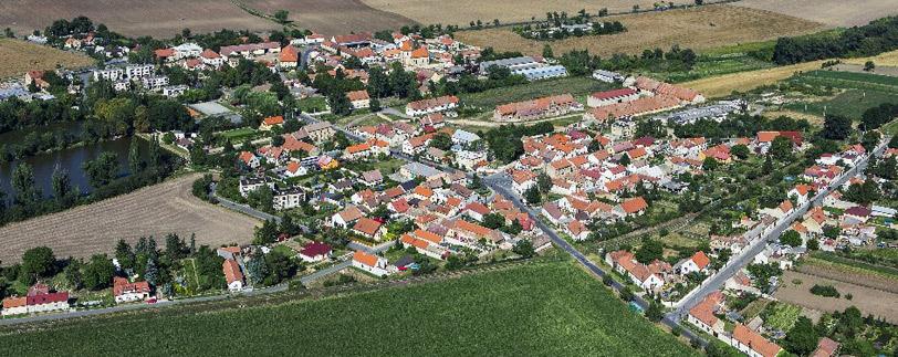 Obec Hospozín a osada Hospozínek s historicky cennou sýpkou a kostelem