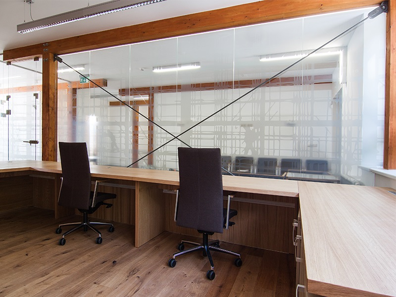 Glass walls, partitions introduce visual ease into offices, living spaces - production Czech Republic