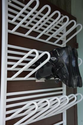 Otopný vysoušeč obuvi