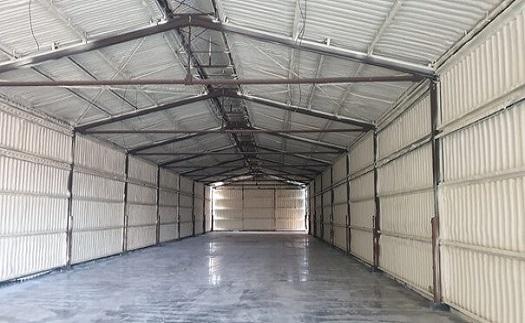 Izolace plechových hal, garáží a kontejnerů stříkanou  pěnovou izolací