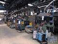 Producción en serie de piezas metálicas de ingeniería.