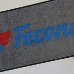 dodávka rohoží s logem Brno