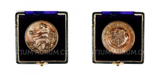 Zlaté a stříbrné mince a plakety