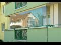 Zasklení lodžií, balkonů a výklenků domů