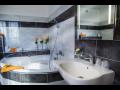 Rekonstrukce koupelen, bytů - montáž keramických obkladů, dlažeb
