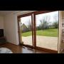 Dřevěné posuvné dveře - elegantní a bezpečný vstup na balkon či terasu, kvalitní výroba