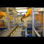 Robotizovaná linka pro balení a paletizaci Chrudim – dopravníková linka pro mlékárenský provoz