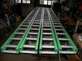 Zakázková výroba dopravníků, elevátorů, robotů