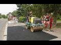 Výstavba a rekonstrukce vozovek, asfaltování chodníků a cest, Praha