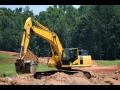 Výkopové práce, terénní úpravy - výkopy sklepů, pro kanalizaci, kabeláž