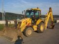 Zemn� pr�ce buldobagrem-pron�jem rypadlonaklada� LB 110 New Holland