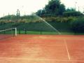 zavla�ov�n� tenisov�ch kurt�