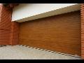 Zateplené sekční garážová vrata v imitaci dřeva