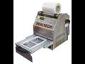 Stroj pro balení do misek