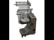 Balící technika pro balení pečiva - profesionální balící stroje pro potravinářský průmysl