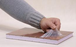 Production of self-adhesive protective foils for carpets, sheets, sandwich panels, plastic plates, aluminum profiles