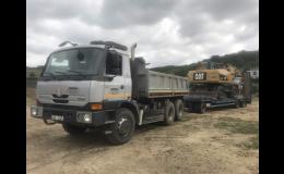 Přeprava strojů a mechanizace nákladními vozy TATRA, IVECO, MAN
