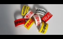 Lepicí potištěné pásky k zabezpečení přepravovaného materiálu
