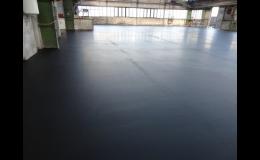 Pokládka antistatické a cementové stěrky do výrobní haly
